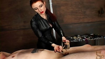 Ponytail women in rubber latex throes in ball busting femdom