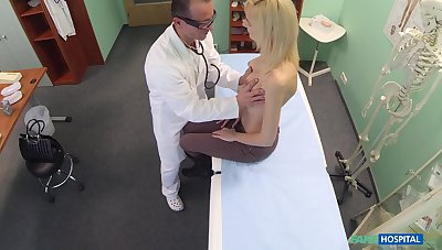 Doctor decides that he needs to examine his blonde patient with his learn of