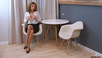 Curly lady Dafna May flashes ass and she is eager to masturbate herself