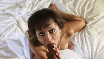 She smiles while milking and riding a broad in the beam dick