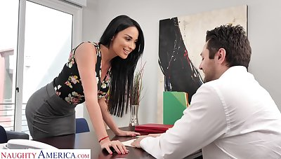 Femme fatale woman Anissa Kate offers herself sedentary on the boss's table