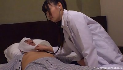 Seductive doctor drops her clothes to be fucked away from a patient